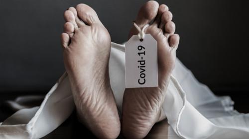 Mort, decedat, mierlit de COVID-19, coronavirus, pe targă, la morgă, deces, cadavru