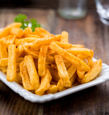 French,Fries,In,A,Bowl,On,A,Wooden,Background