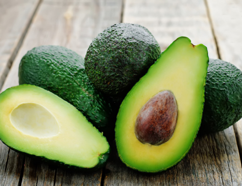 Avocado,On,A,Dark,Wood,Background.,Tinting.,Selective,Focus