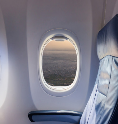 Empty,Seat,Airplane,And,Window,View,Inside,An,Aircraft