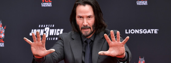 Keanu Reeves Places His Hand Prints In Cement At TCL Chinese Theatre IMAX Forecourt