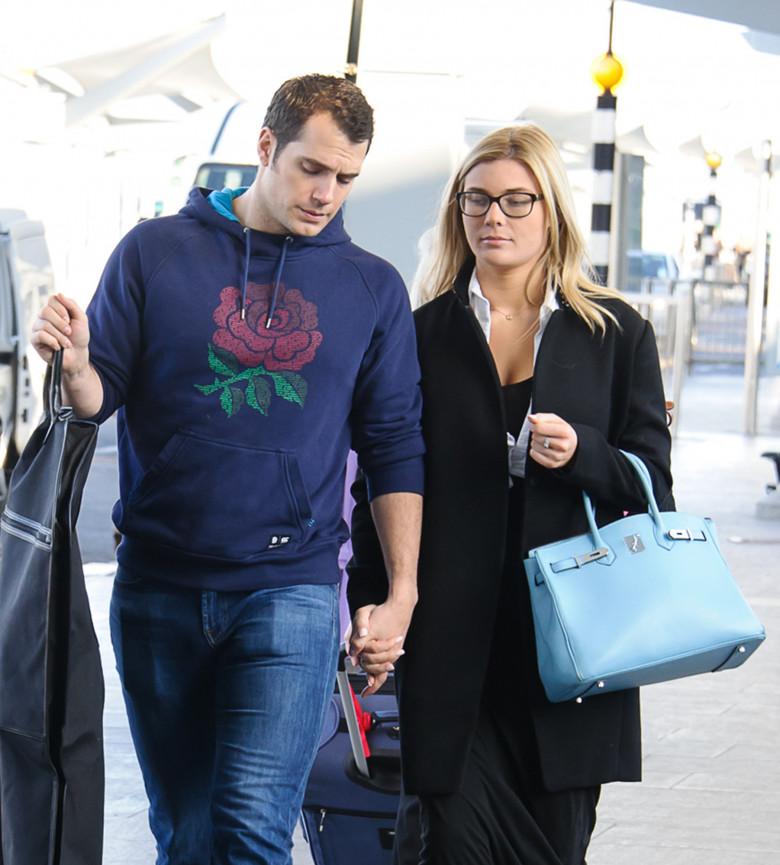 EXCLUSIVE: Henry Cavill and Tara King depart Heathrow Airport