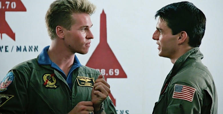 USA. Tom Cruise and Val Kilmer   in a scene from the ©Paramount Pictures cult movie: Top Gun (1986).Plot:  As students at the United States Navy's elite fighter weapons school compete to be best in the class, one daring young pilot learns a few things fr