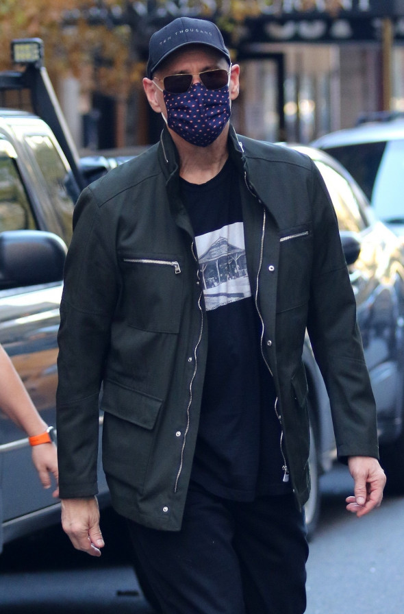 Jim Carrey is all smiles as he wears a colorful mask while heading to lunch in NYC