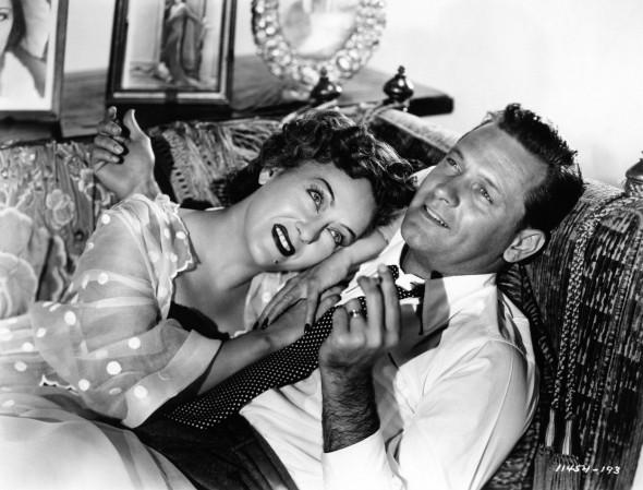 GLORIA SWANSON as Norma Desmond and WILLIAM HOLDEN as Joe Gillis in SUNSET BOULEVARD 1950 director BILLY WILDER writers CHARLES BRACKETT BILLY WILDER and D. M. MARSHMAN Jr Costume design EDITH HEAD Paramount Pictures