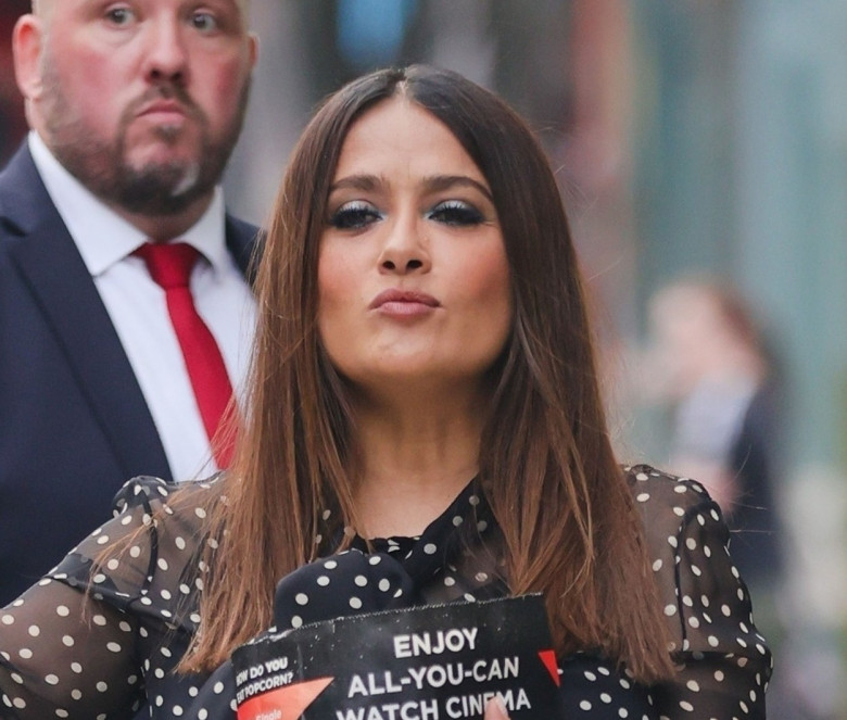 *EXCLUSIVE* Salma Hayek is seen eating popcorn as she leaves the premiere of The Hitman's Wife's Bodyguard.