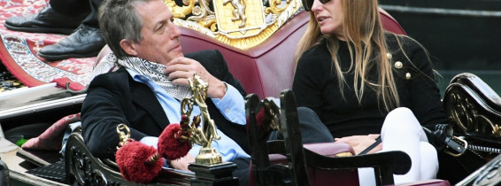 *PREMIUM-EXCLUSIVE* *MUST CALL FOR PRICING* - The British Actor Hugh Grant and wife Anna Elisabet Eberstein pictured looking relaxed and taking selfie's as they enjoy a romantic gondola ride on the Venetian waters on their holiday out in Venice.