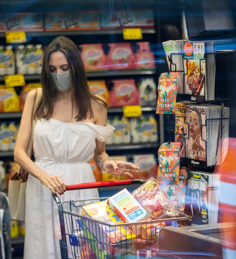 EXCLUSIVE: Angelina Jolie Looks Elegant In A White Dress As She Shops For Groceries In New York
