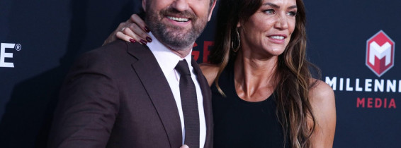 Westwood, United States. 20th Aug, 2019. WESTWOOD, LOS ANGELES, CALIFORNIA, USA - AUGUST 20: Actor Gerard Butler and girlfriend Morgan Brown arrive at the Los Angeles Premiere Of Lionsgate's 'Angel Has Fallen' held at the Regency Village Theatre on August