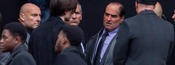 Robert Pattinson and a unrecognizable Colin Farrell are seen on the film set of Batman.