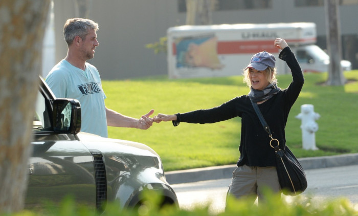 EXCLUSIVE: Renee Zellweger Gets Swept Off Her Feet for a Romantic Kiss by Beau Ant Anstead in Los Angeles.