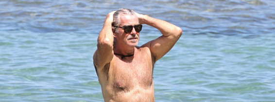 EXCLUSIVE: Pierce Brosnan takes off his shirt and takes a dip while in Hawaii