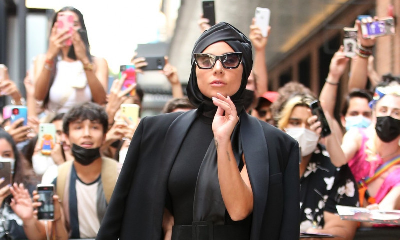 Lady Gaga tosses a bouquet of flowers as she leaves Highline Stages in New York City