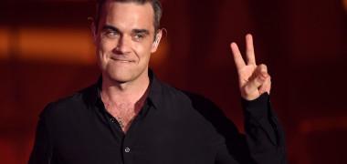 Robbie Williams își face trupă nouă, la 25 de ani după ce a renunțat...