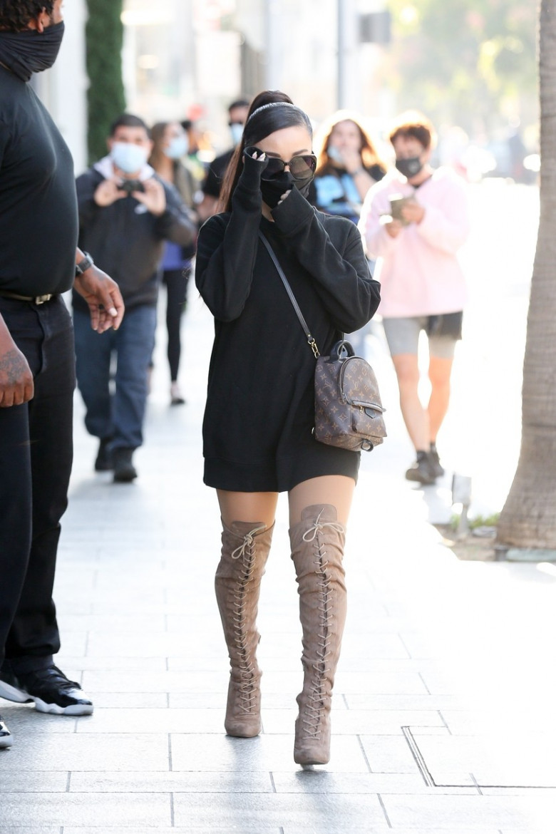 Ariana Grande turn heads while out doing some shopping