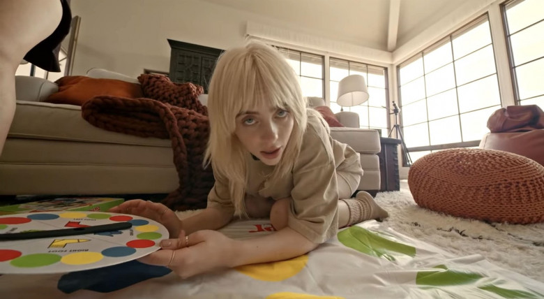 Billie Eilish shows off her stunning figure as she cavorts in bed with her girlfriends in latest music video