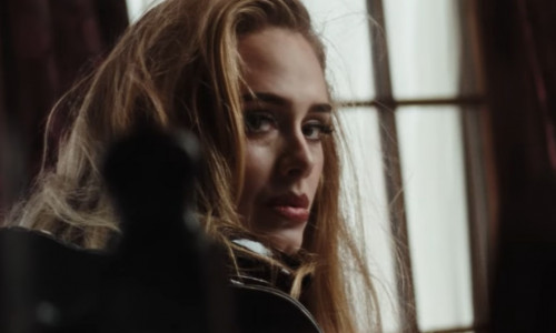 Adele returns with a video preview for her new song 'Easy on Me'