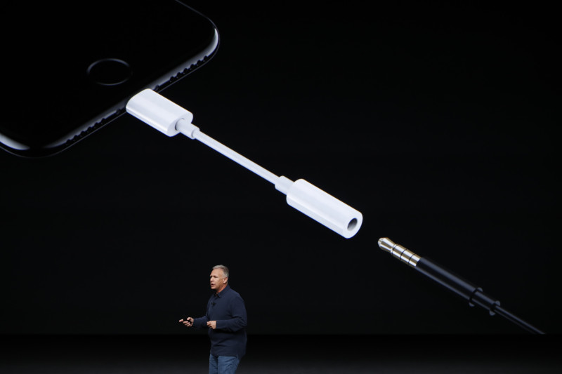 SAN FRANCISCO, CA - SEPTEMBER 07: Apple Senior Vice President of Worldwide Marketing Phil Schiller introduces a Lightning to 3.5 mm audio jack adapter during a launch event on September 7, 2016 in San Francisco, California. Apple Inc. is expected to unveil latest iterations of its smart phone, forecasted to be the iPhone 7. The tech giant is also rumored to be planning to announce an update to its Apple Watch wearable device. (Photo by Stephen Lam/Getty Images)