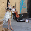 Famke Janssen takes pictures of art on boarded stores windows in Soho, NYC