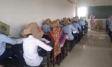 Elevii unui liceu au purtat cutii pe cap, pentru a nu copia la examen