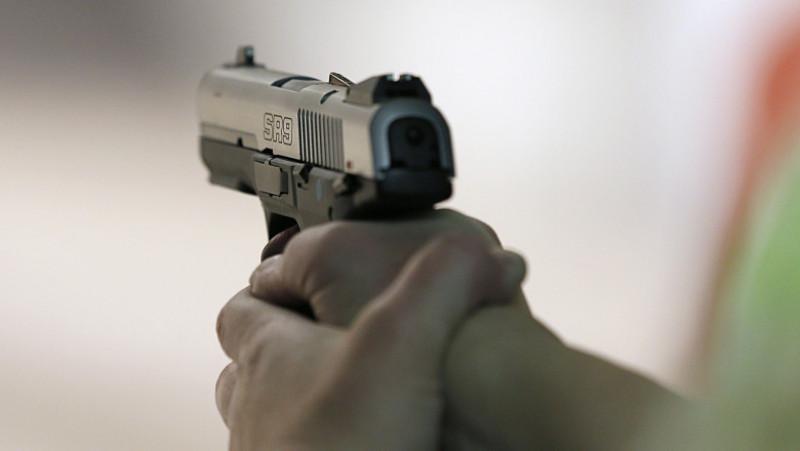 Firearms Enthusiasts Practice Shooting At Gun Range