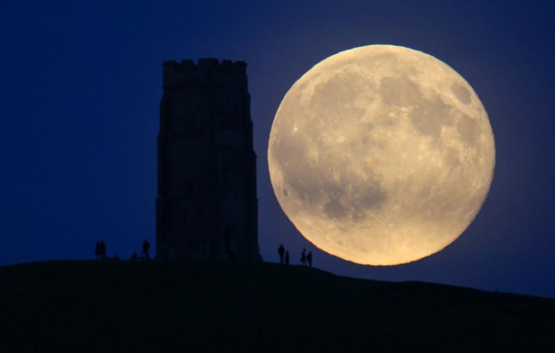 Blue Moon Rises Over Glastonbury Tor