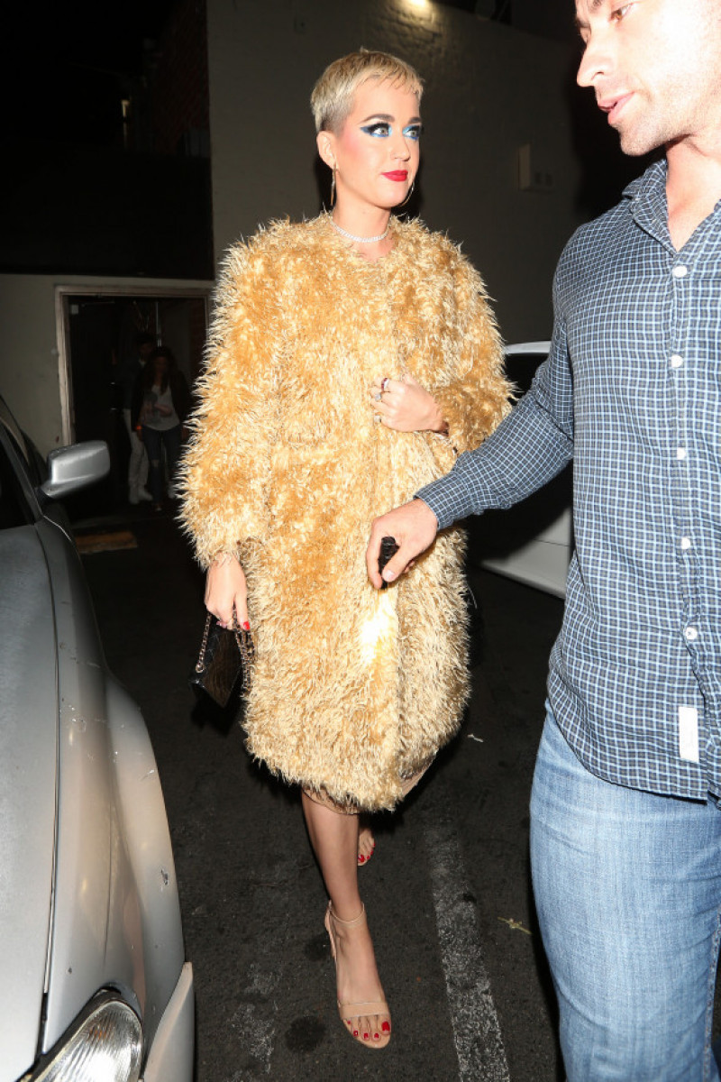 Singer Katy Perry is dressed in 1930's fashion style as she leaves the Delilah club at 2:30 A.M. in the morning