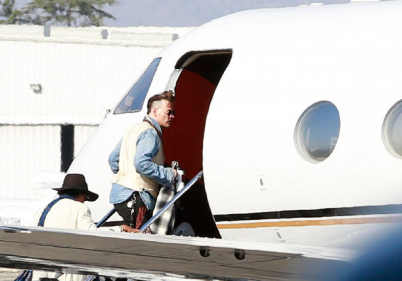EXCLUSIVE: *****PREMIUM EXCLUSIVE RATES APPLY****   Johnny Depp seen catching a private plane out of Los Angeles with his dogs as his divorce from Amber Heard heats up.