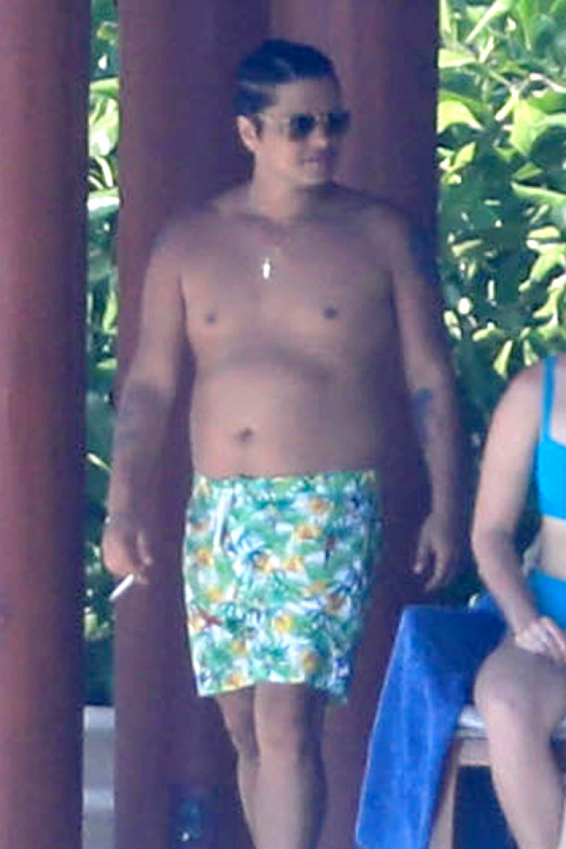 *EXCLUSIVE* Bruno Mars looks to have packed on the pounds while on vacation with girlfriend Jessica Caban