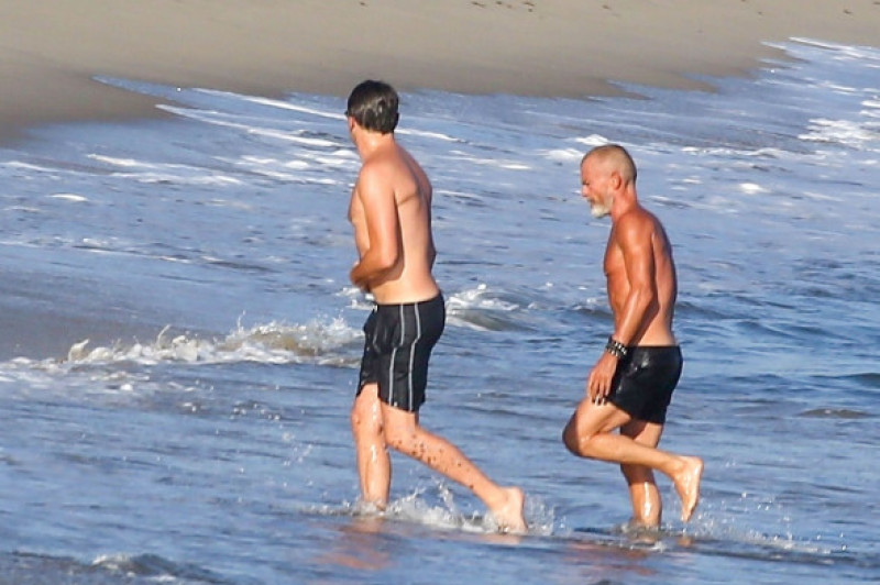 Leonardo Dicaprio appears self-conscious when spotted shirtless in Malibu
