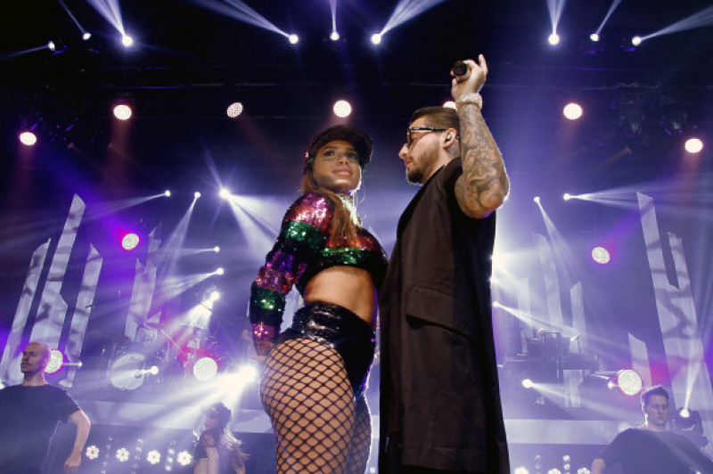 Latin sensation Maluma makes out with Brazilian superstar Anitta on stage as Marlon Wayans wacthes in Rio