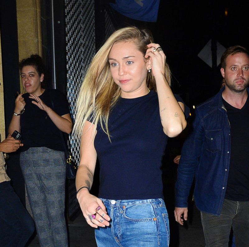 EXCLUSIVE: Miley Cyrus is all smiles as she arrives to a club in New York City