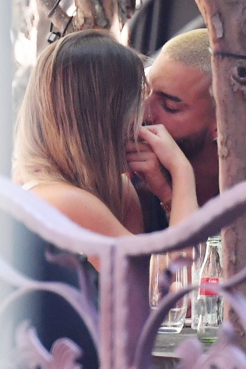 *EXCLUSIVE* Maluma packs on the PDA during lunch!