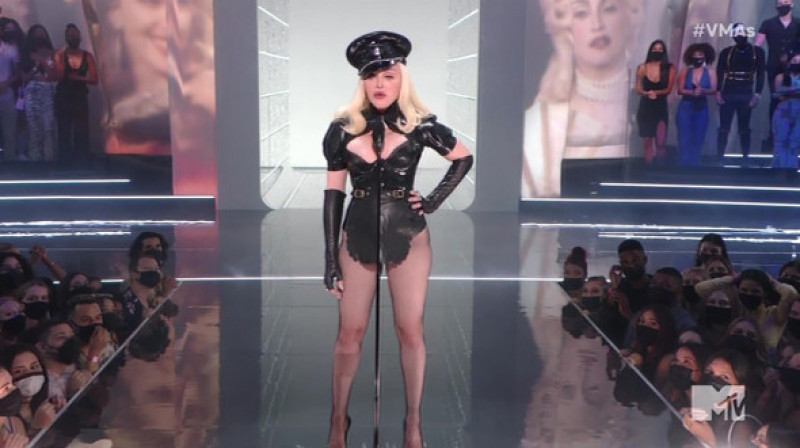 Madonna makes a surprise appearance in a raunchy leather outfit to kick off the MTV Video Music Awards