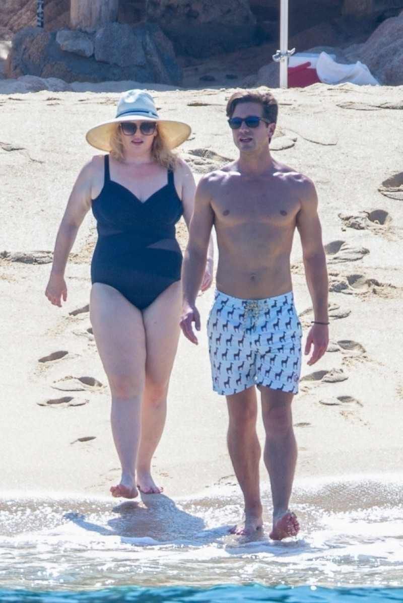 *PREMIUM-EXCLUSIVE* Rebel Wilson shows off her amazing, slimmed down beach body while on a romantic getaway with boyfriend Jacob Busch. *Web Embargo until 3:50 PM ET on October 13, 2020*