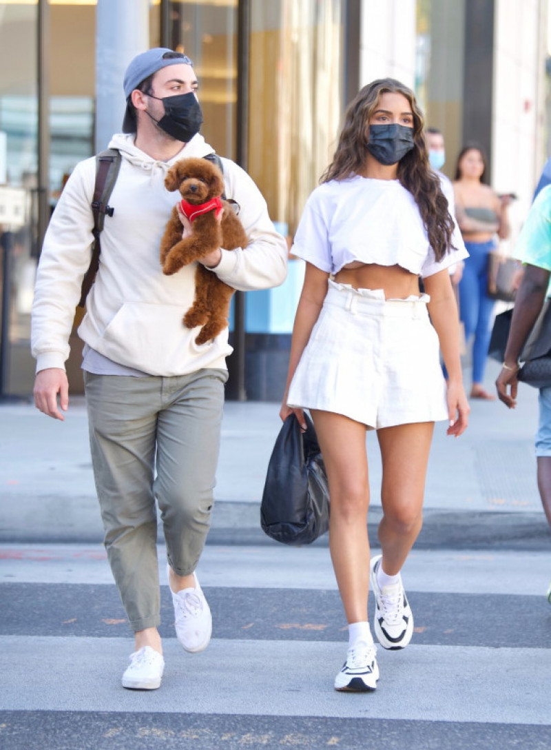 EXCLUSIVE: Olivia Culpo Flashes Her Toned Torso While Shopping On Rodeo Drive With Her Adorable Puppy, Oliver Sprinkles