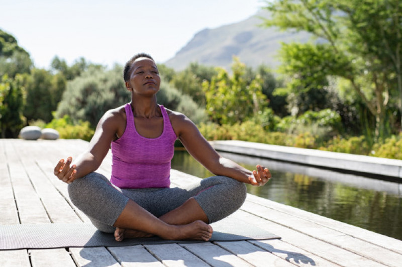 Mature black woman in lotus position